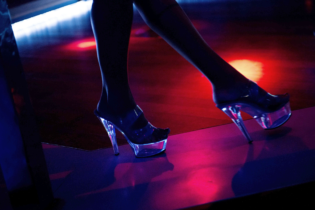 A dancer performs at a strip club.