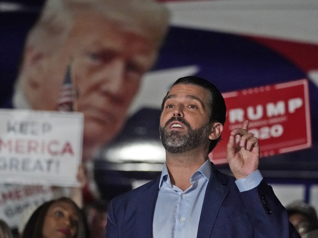 In this Nov. 5 photo, Donald Trump Jr. gestures during a news conference at Georgia Republican Party headquarters in Atlanta. Trump Jr. has been infected with the coronavirus but says he is currently asymptomatic.