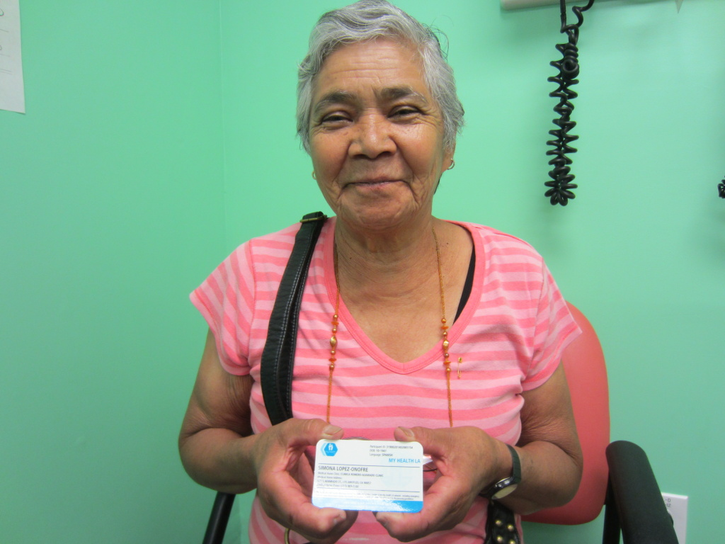 Simona Lopez, a 68-year-old Mexican immigrant who's lived in the U.S. without legal status for ten years, shows off her membership card for My Health L.A.