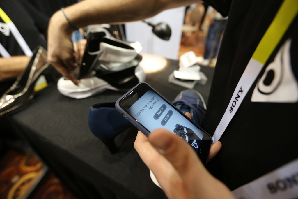 A smartphone app is used to automatically tighten Digisole smart shoes at The CES Unveiled press event, January 4, 2016 in Las Vegas, Nevada ahead of the CES 2016 Consumer Electronics Show.