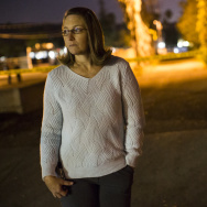 Gayle Perez, who lives on Center Street, waits near Center Street at Pine Avenue on Wednesday night, Dec. 2, 2015 as authorities serve a search warrant following a mass shooting inside the the Inland Regional Center in San Bernardino on Wednesday, Dec. 2, 2015.