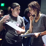 "Teaching artist in training Anthony ""Chuck"" Gloria, left, works with animation co-directors Ruah Edelstein and Masha Vasilkovsky on a performance blending music and animated pieces."