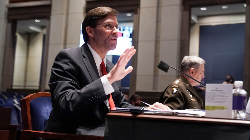 Defense Secretary Mark Esper (left) and Gen. Mark Milley, chairman of the Joint Chiefs of Staff, testify Thursday before a House Armed Services Committee hearing.