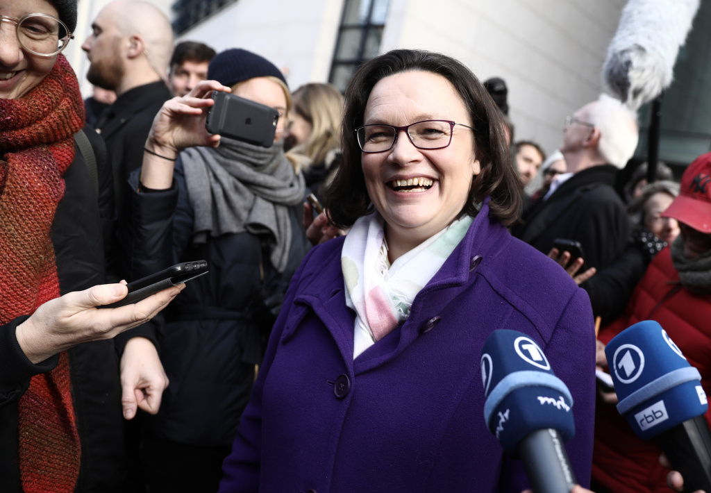 Andrea Nahles, parliamentary group leader of Germany's Social Democrats (SPD) party and also designated SPD leader, smiles as she gives a statement after a party referendum on whether or not to join a new coalition government with German Chancellor Angela Merkel's conservatives, on March 4, 2018.