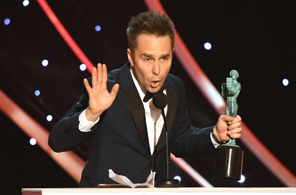 Sam Rockwell accepts the Outstanding Performance by a Male Actor in a Supporting Role award for 'Three Billboards Outside Ebbing, Missouri' onstage  during the 24th Annual Screen Actors Guild Awards show at The Shrine Auditorium on January 21, 2018 in Los Angeles, California. / AFP PHOTO / Mark RALSTON        (Photo credit should read MARK RALSTON/AFP/Getty Images)