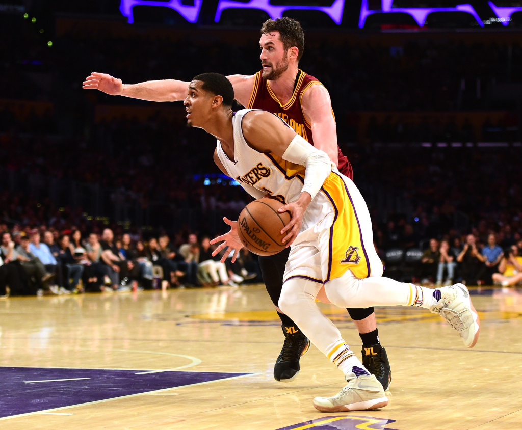 LOS ANGELES, CA - MARCH 19:  Jordan Clarkson #6 of the Los Angeles Lakers drives to the basket on Kevin Love #0 of the Cleveland Cavaliers during a 125-120 Cavaliers win at Staples Center on March 19, 2017 in Los Angeles, California.  NOTE TO USER: User expressly acknowledges and agrees that, by downloading and or using this photograph, User is consenting to the terms and conditions of the Getty Images License Agreement.  (Photo by Harry How/Getty Images)