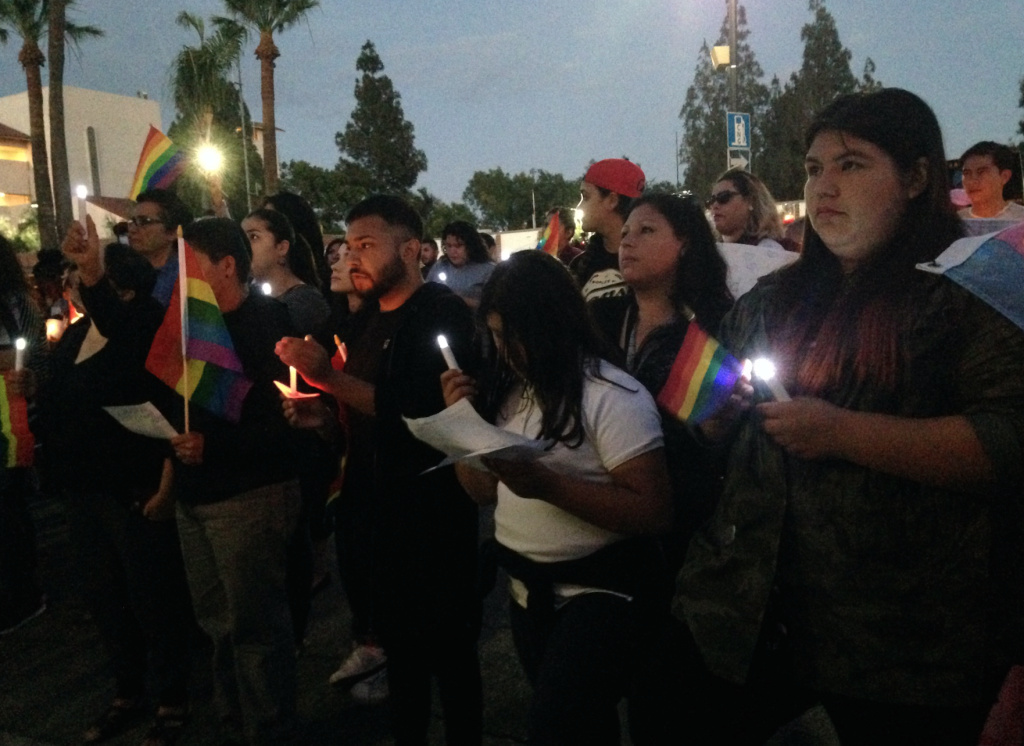 Mourners hold a vigil in San Fernando last week for the victims of the shooting at Pulse, a gay nightclub in Orlando. The vast majority of the victims were Latino. Organizers of the San Fernando vigil and other gatherings say they want to create safe spaces for LGBT Latinos to talk about the tragedy.