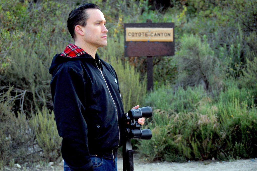 Jamie Stewart of the band Xiu Xiu birdwatching at Eaton Canyon Natural Area in Pasadena