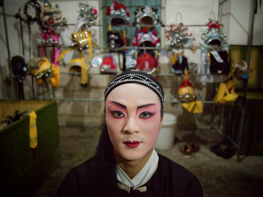 Cheng Zhigui, 23, is dressed to perform in a traditional opera during celebrations for the 1050th birthday of folk goddess Mazu on the island of Meizhou, in southern China's Fujian province.