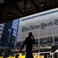 A man speaks on his mobile phone across from The New York Times headquarters building April 21, 2011 in New York City.