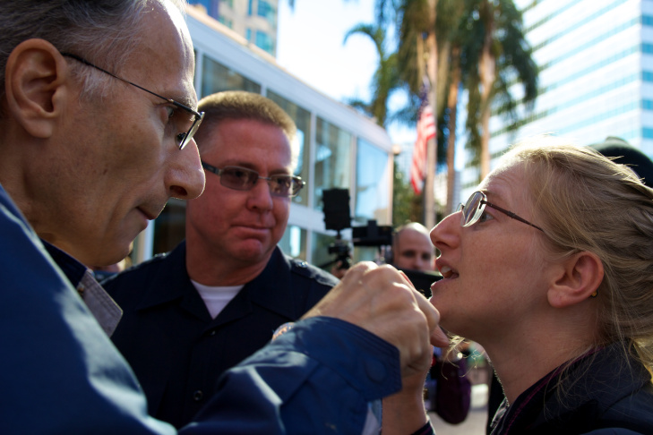 Dominic Peppe argues with Occupy LA organizer Cheryl Aichele after Peppe expressed his contempt for the group.