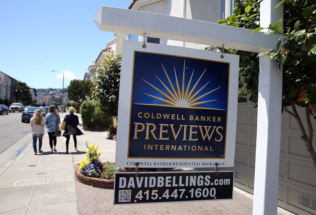 A realtor sign is posted in front of a home for sale on May 28, 2013 in San Francisco, California.