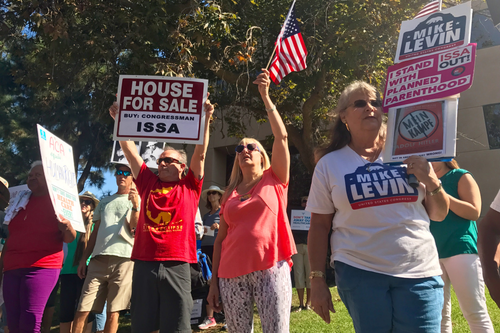 Protesters outside California Congressman Darrell Issa's Vista office in September 2017.
