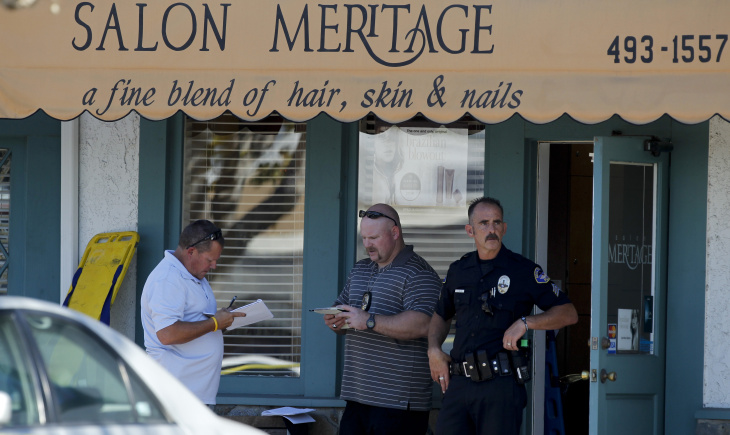 An onlooker reacts near the site where six people were killed and three were wounded in a shooting at a hair salon in Seal Beach, Calif., Wednesday, Oct. 12, 2011.