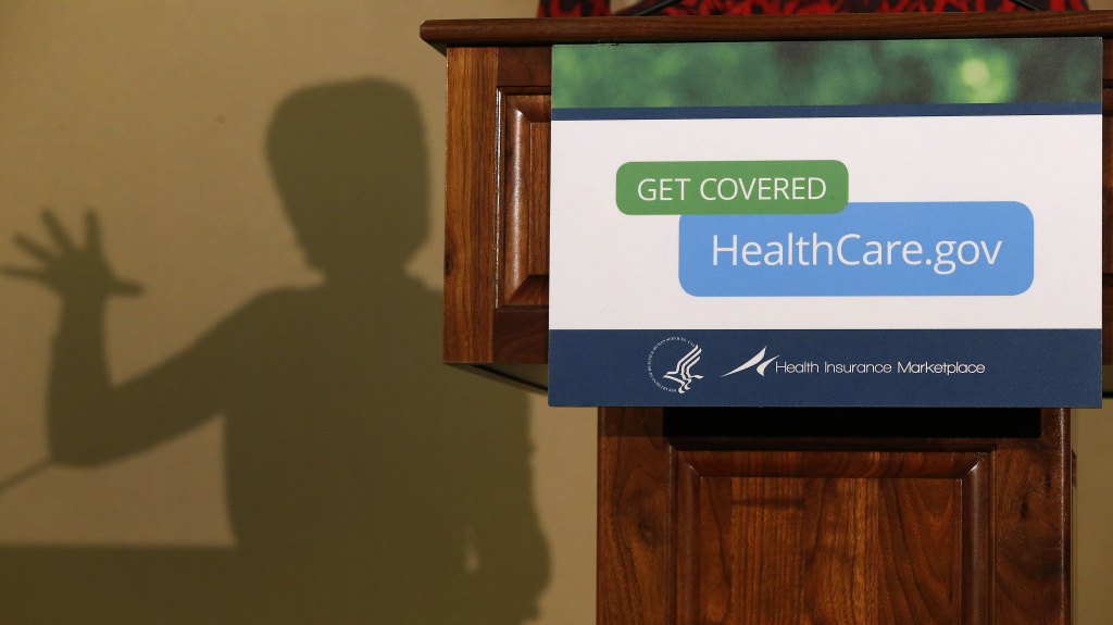 Health and Human Services Secretary Kathleen Sebelius' shadow appeared behind the lectern as she about the implementation of the federal health law in Detroit in November.