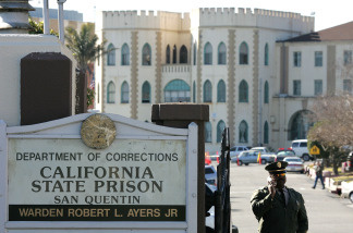 A guard stands at the entrance to the California State Prison at San Quentin.