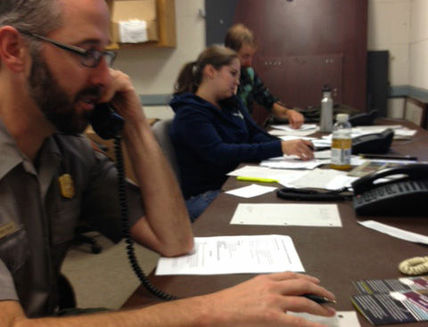 Rangers (from left) Paul Ollig, Kirsten Randolph, Adam Ramsey field calls from between 300 to 500 people a day who are calling the park to learn more about the hantavirus outbreak there.