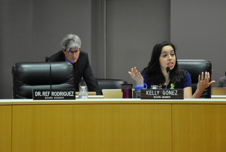 L.A. Unified School Board member Kelly Gonez (right) speaks during a board meeting on Tues., Sept. 19, 2017. Next to her, the seat belonging to then-board member Ref Rodriguez sits empty.