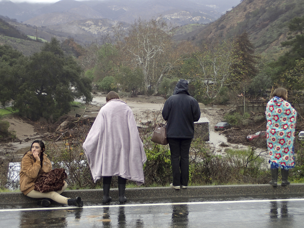 Rescued campers survey the scene at the El Capitan Canyon campground following flooding due to heavy rains Friday, Jan. 20, 2017 in Gaviota, Calif.