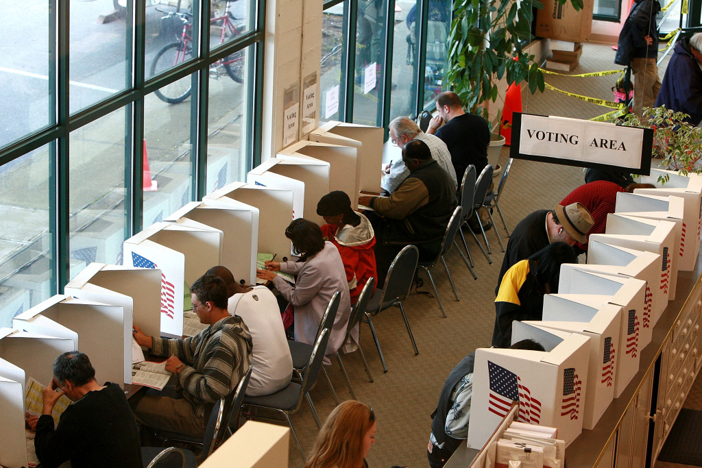 Voters cast ballots at the Multnomah County elections office.