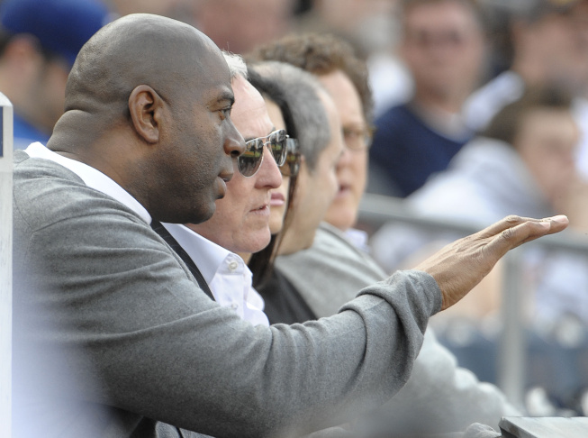 Magic Johnson (L) sits with Frank McCourt during the game between the Los Angeles Dodgers and the San Diego Padres in the home opener at Petco Park on April 5, 2012 in San Diego, California.
