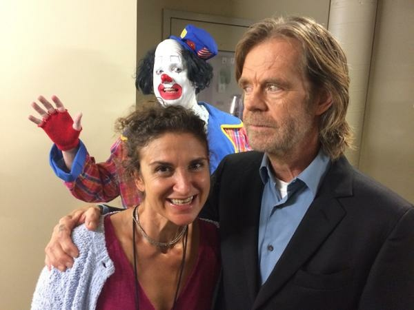 William H. Macy spoke with Take Two's Alex Cohen last week about directing his first film. Caption this photo of a clown photobombing them.