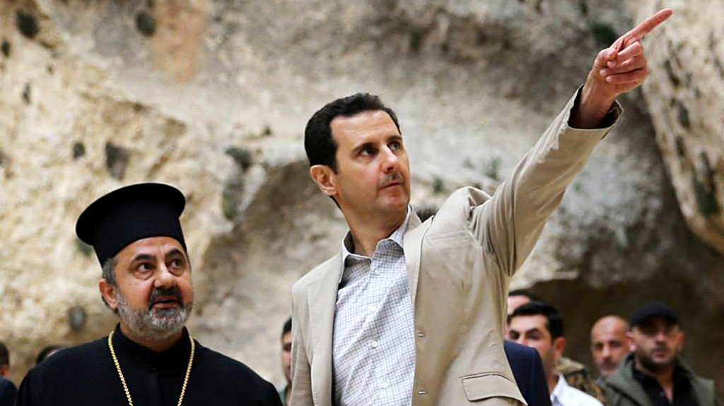Syrian President Bashar Assad (right) visits the Christian village of Maaloula, near Damascus on Sunday. Assad's forces have been gaining the upper hand in the fighting and the CIA is now increasing training and aid to Syrian rebels.