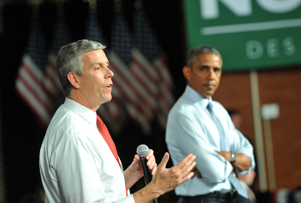 U.S. Secretary of Education Arne Duncan speaks alongside U.S. President Barack Obama at a town hall style meeting at North High School in this September 14, 2015 file photo in Des Moines, Iowa. Duncan announced Friday, October 2, 2015, he will step down following a seven-year tenure marked by a willingness to plunge head-on into the heated debate about the government's role in education.