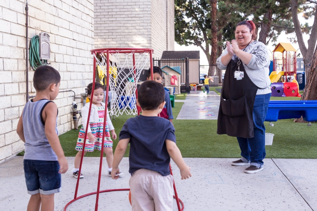 Rosa Lopez with 3 and 4-year-olds at the Mexican American Opportunity Foundation's child care center in Norwalk.