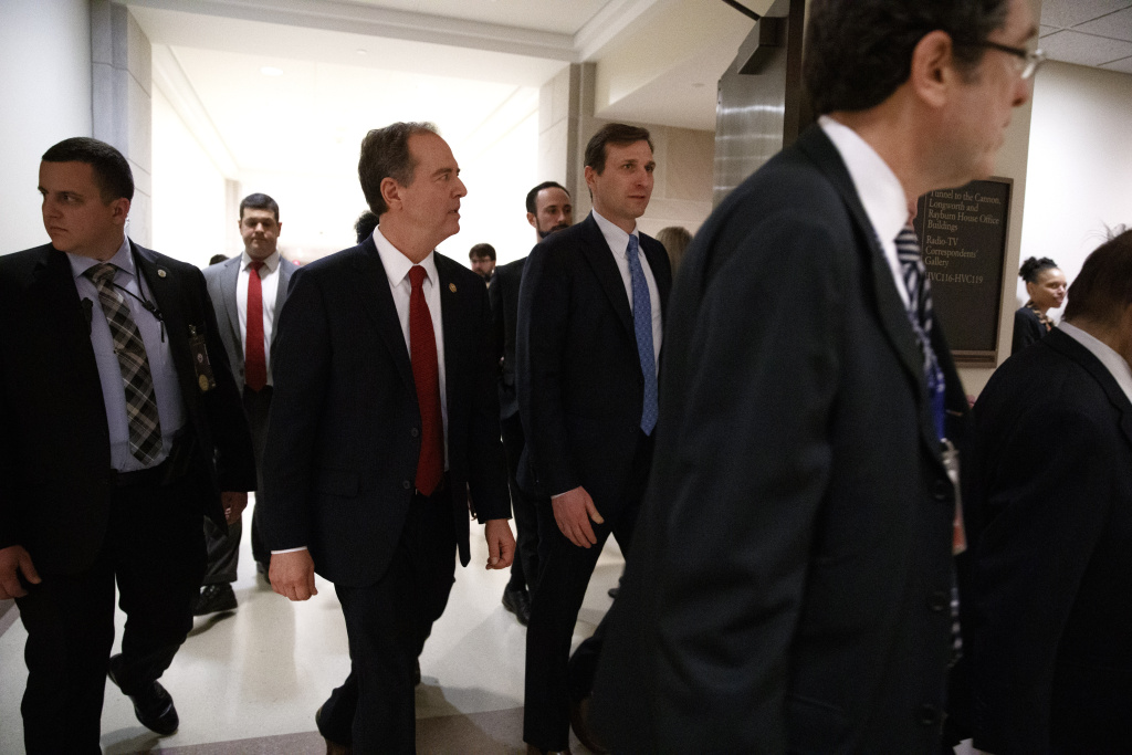 House Democratic impeachment manager Rep. Adam Schiff, D-Calif., second from left, walks on Capitol Hall after a news conference with the House Democratic impeachment managers on Tuesday.