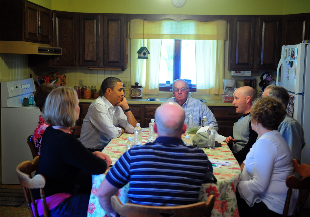 US President Barack Obama sits at a kitchen table discussion with family after visiting farm in Missouri.