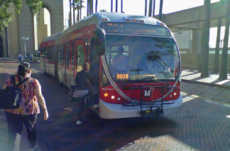 Los Angeles County commuters rush to board the 704 bus at L.A. Union Station.