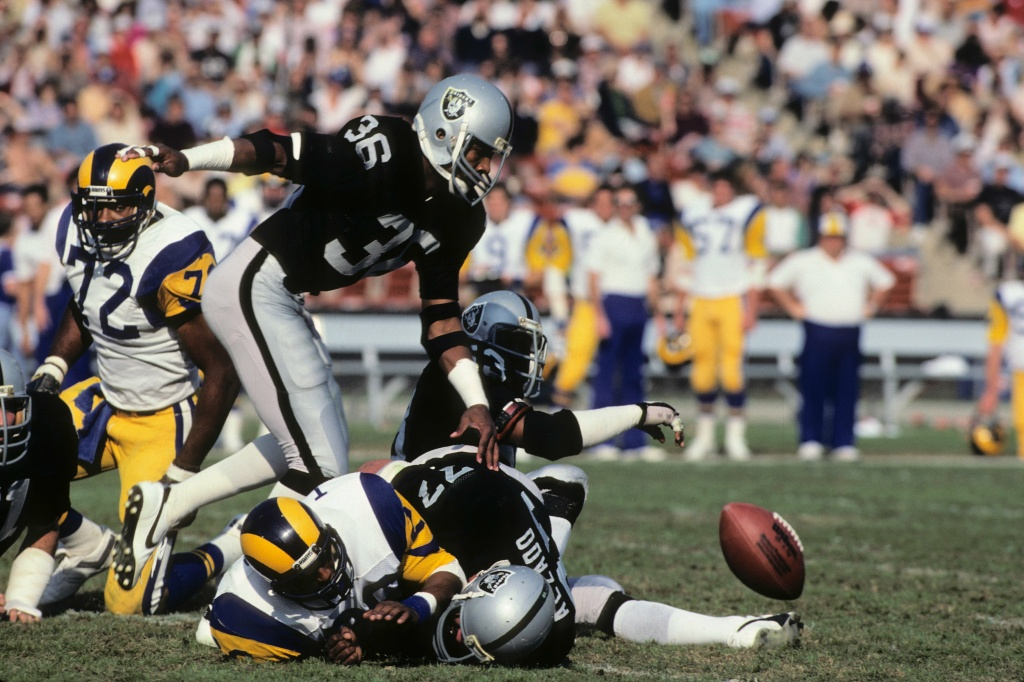 The Raiders and the Rams during a game at the Los Angeles Memorial Coliseum on December 18, 1982 in Los Angeles, California. Both teams have been rumored in discussions about bringing a NFL team to Los Angeles.