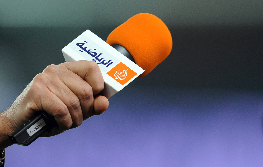 A picture taken on March 21, 2012 shows a microphone with the logo of Qatar-based broadcaster Al Jazeera before the French Cup football match Paris vs. Lyon on March 21, 2012 at the Parc des Princes stadium in Paris.