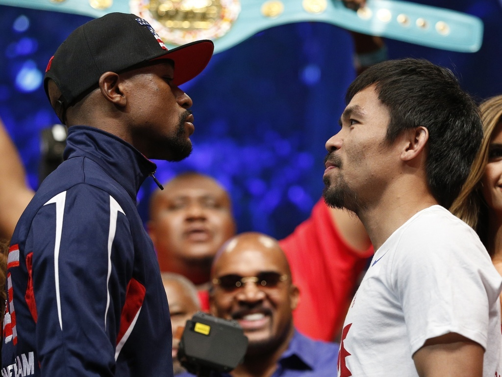 Floyd Mayweather Jr., left, and Manny Pacquiao pose during their weigh-in on Friday, in Las Vegas. The world weltherweight title fight between the two will begin tonight at 8 p.m. ET.