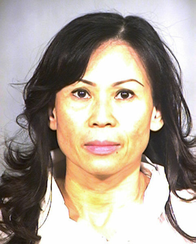 This undated handout photo provided by the Garden Grove Police Dept., shows a police booking photo of Catherine Kieu Becker, 48, who police say drugged her estranged husband, tied him to a bed, cut off his penis with a knife and threw it down a garbage disposal in her home in Garden Grove.