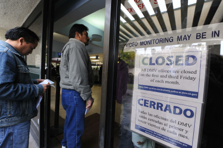 People wait in line to get into a California Department of Motor Vehicles office in Los Angeles in February 2009. The DMV is training 900 newly hired employees in anticipation of a crush of applications this January, when immigrants without legal status may begin applying for a special driver's license under a new law.