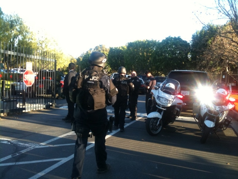 Swat teams suit up to sweep the SoCal Edison building.