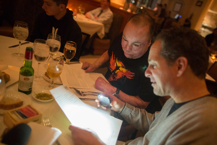 Israel Del Toro, an Air Force Sergeant, and Michael Schwimmer, a TV executive from Sherman Oaks, share a meal in Westwood. Del Toro is receiving free reconstructive surgery from UCLA; Schwimmer's family keep him company through his recovery.