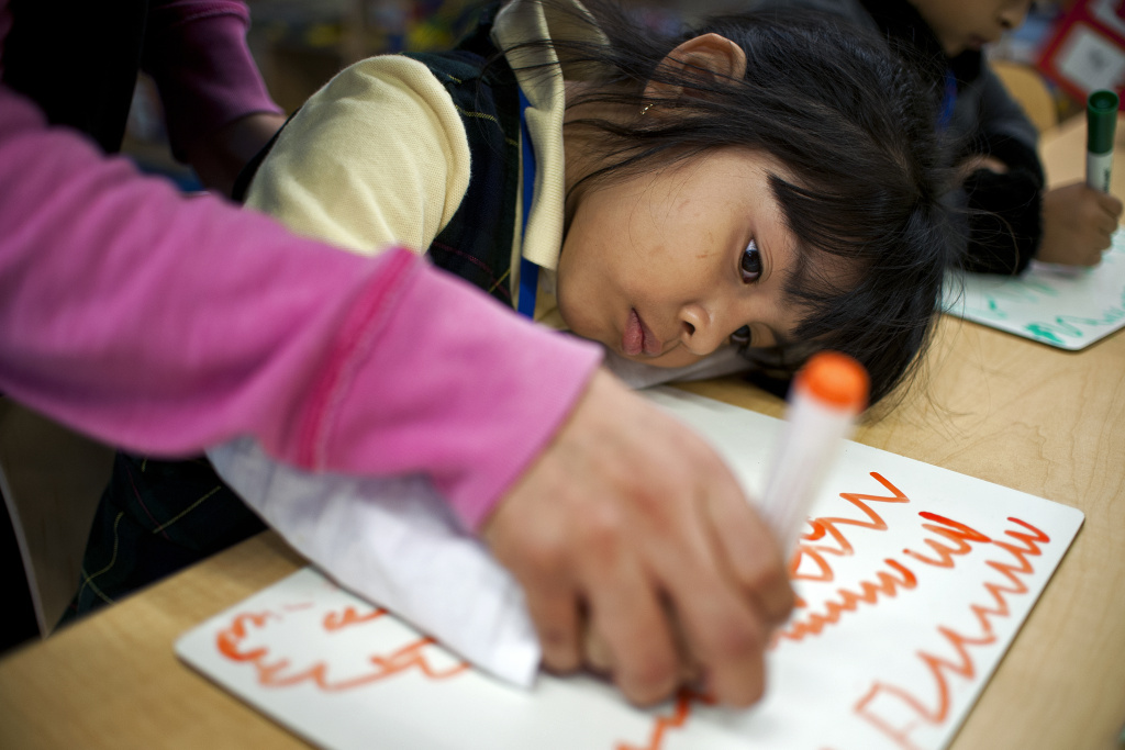 Preschoolers take part in a drawing exercise at Camino Nuevo Charter Academy's Burlington Campus on Wednesday, Jan. 8.