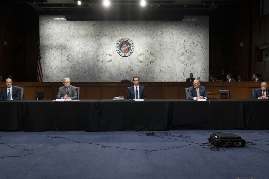 Socially distanced apart, Secretary of Labor Eugene Scalia, Senate Majority Leader Mitch McConnell (R-KY), U.S. Treasury Secretary Steven Mnuchin, Senate Minority Leader Chuck Schumer (D-NY), and Director of the National Economic Council Larry Kudlow attend a meeting with a select group of Senate Republicans, Senate Democrats, and Trump administration officials in the Hart Senate Office Building on Capitol Hill March 20, 2020 in Washington, DC.