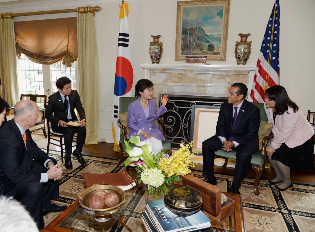 South Korean President Park Geun-hye, in purple dress, speaks with California Gov. Jerry Brown, far left, and Los Angeles Mayor Antonio Villaraigosa, as their translators listen in the foyer of Getty House.