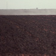Treated sewer sludge is spread over a field owned by Shaen Magen, near Corcoran, California. If it weren't for the constant shipments of human waste from Southern California's cities, Kern County farmer Shaen Magen says his farm would dry up and blow away.