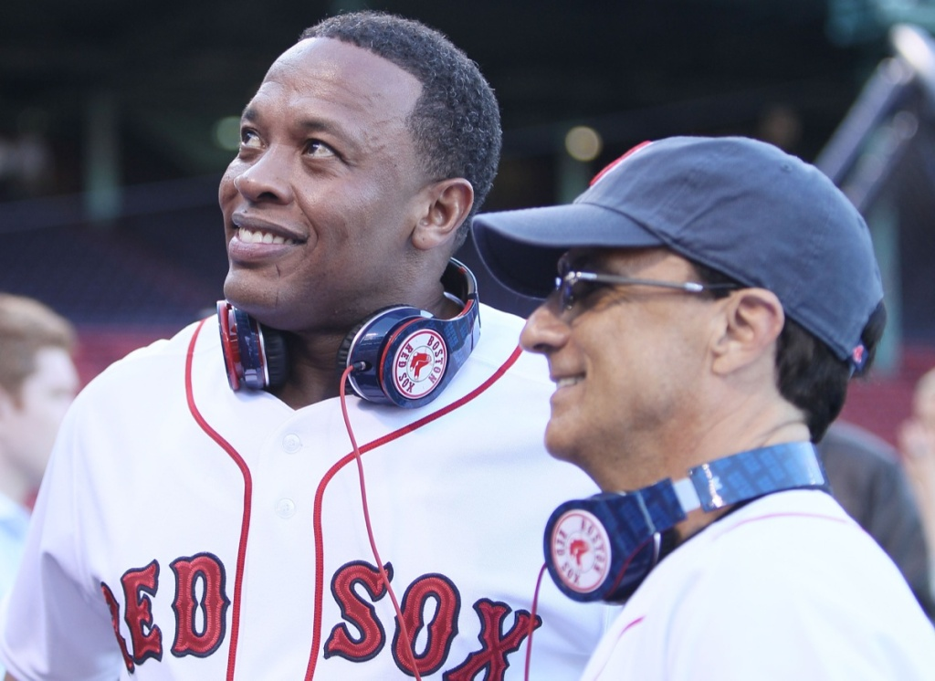 Producer and musician Dr. Dre and Interscope and Geffen Records chairman Jimmy Iovine are on the field before the Boston Red Sox take on the the New York Yankees on April 4, 2010 during Opening Night at Fenway Park in Boston, Massachusetts.