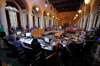 The Los Angeles City Council is considering a proposal to issue identification cards that would allow illegal immigrants to open bank accounts.