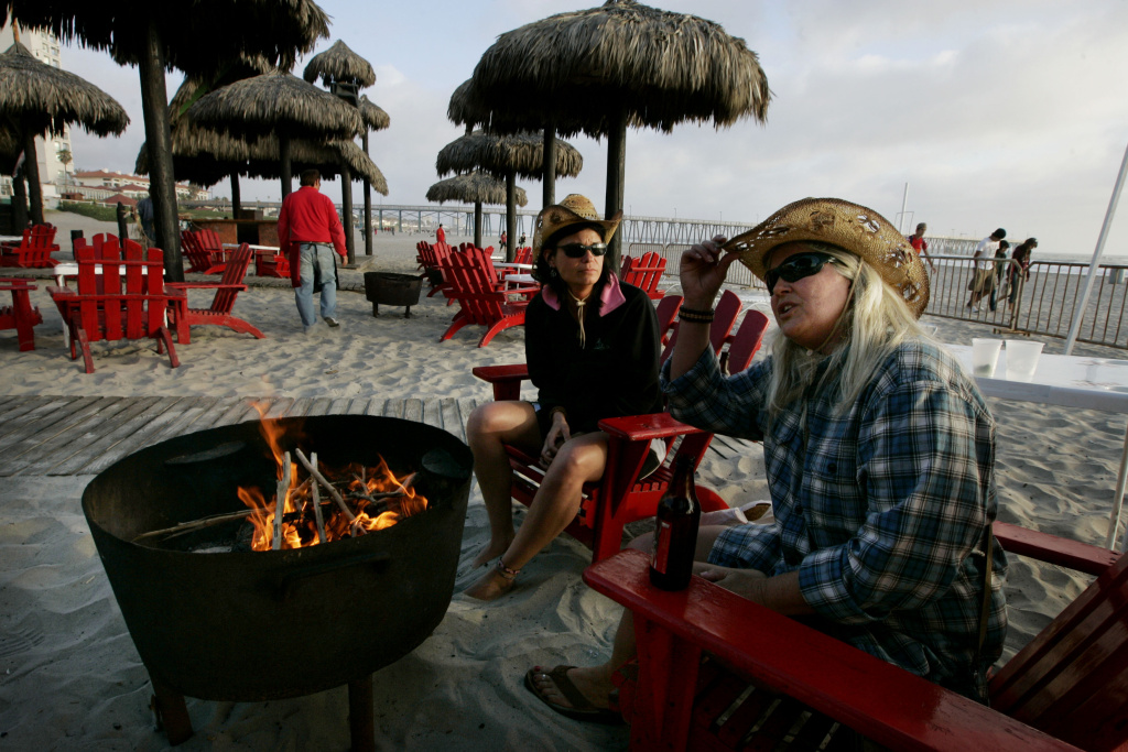 Carol Arthur (R) and Tammy Delu, from Seattle, sit at a bar along the beach April 1, 2009 in Rosarito, Mexico.  The tourist industry in some northern Mexican resort towns is feeling the effects of the ongoing drug war, as students from the U.S. are curtailing their spring break plans and traveling domestically instead.