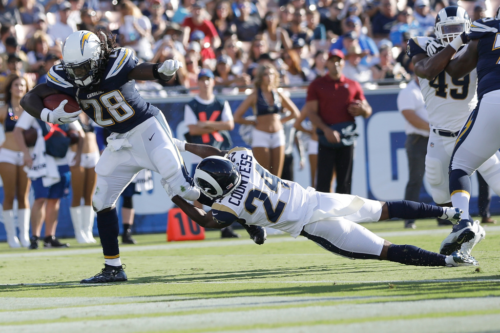 LOS ANGELES, CA - AUGUST 26:  Melvin Gordon #28 of the Los Angeles Chagers breaks free from Blake Countess #24 of the Los Angeles Rams in the first quarter of the preseason game between the Los Angeles Rams and Los Angeles Chargers at the Los Angeles Memorial Coliseum on August 26, 2017 in Los Angeles, California.  (Photo by Josh Lefkowitz/Getty Images)