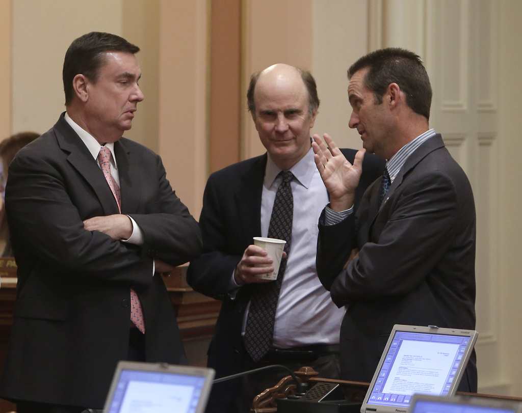 Republican state Senators, Joel Anderson of Alpine, left, Mark Wyland of Escondido, center, and Steve Knight of Palmdale confer as the Senate debated a bill regarding transgender students, at the Capitol in Sacramento on July 3, 2013. Anderson, Wyland and Knight voted against the measure.