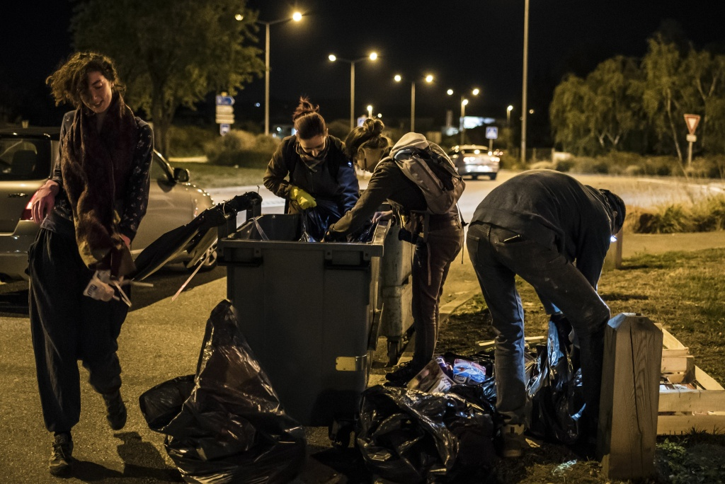 Members of the movement 'Les Gars'Pilleurs' collect food from waste containers of a supermarket in the south of Lyon, France on late September 24, 2015.