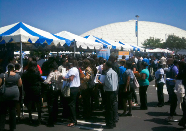Job seekers crowd the Delta Airlines and BNSF tables in parking lot at Crenshaw Christian Center.
